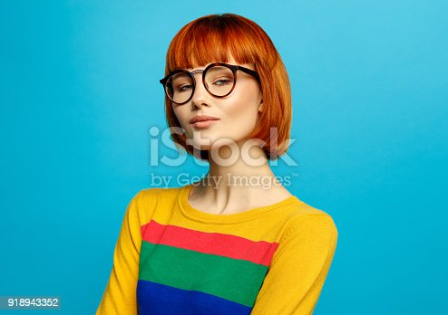 876629044istockphoto Portrait of young woman 918943352