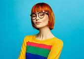 Portrait of beautiful female model with glasses