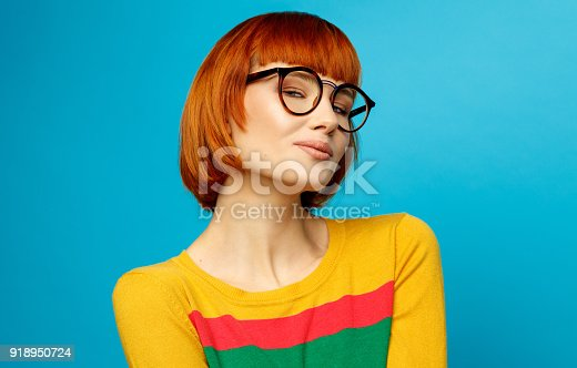 876629044istockphoto Portrait of young woman 918950724