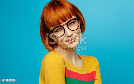 876629044istockphoto Portrait of young woman 918965654