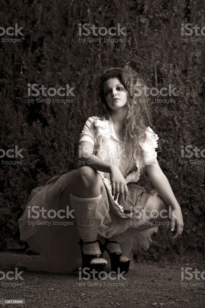 Portrait of Young Woman Posing in Garden, Black and White royalty-free stock photo