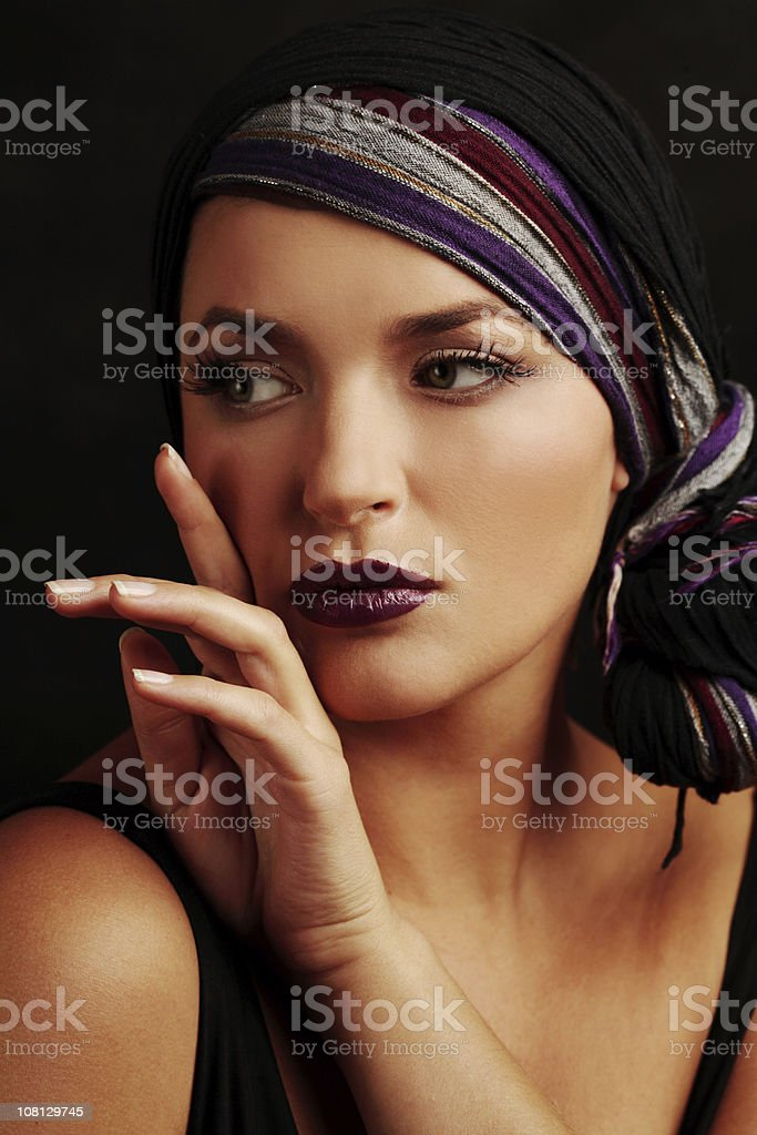 Portrait of Young Woman Posing Wearing Make-Up and Head Scarf royalty-free stock photo