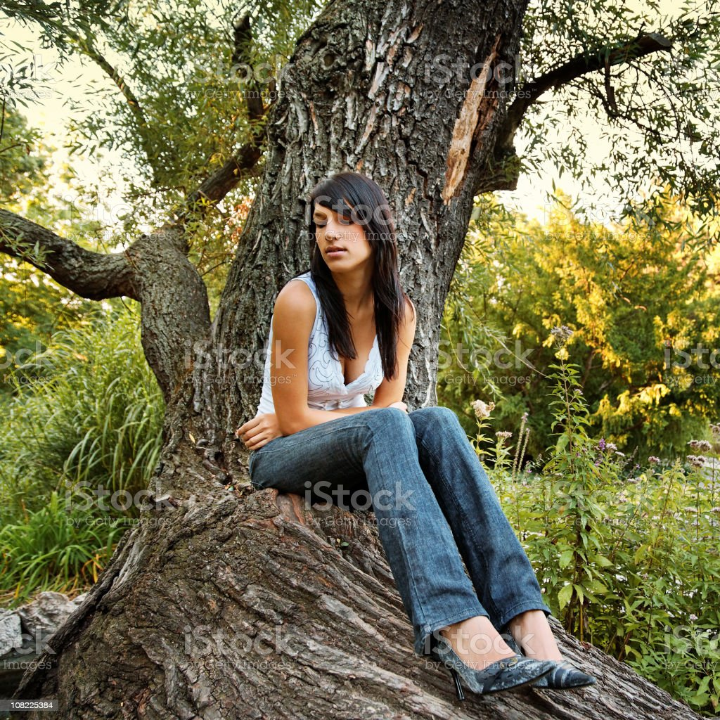 Portrait of Young Woman Sitting on Tree royalty-free stock photo