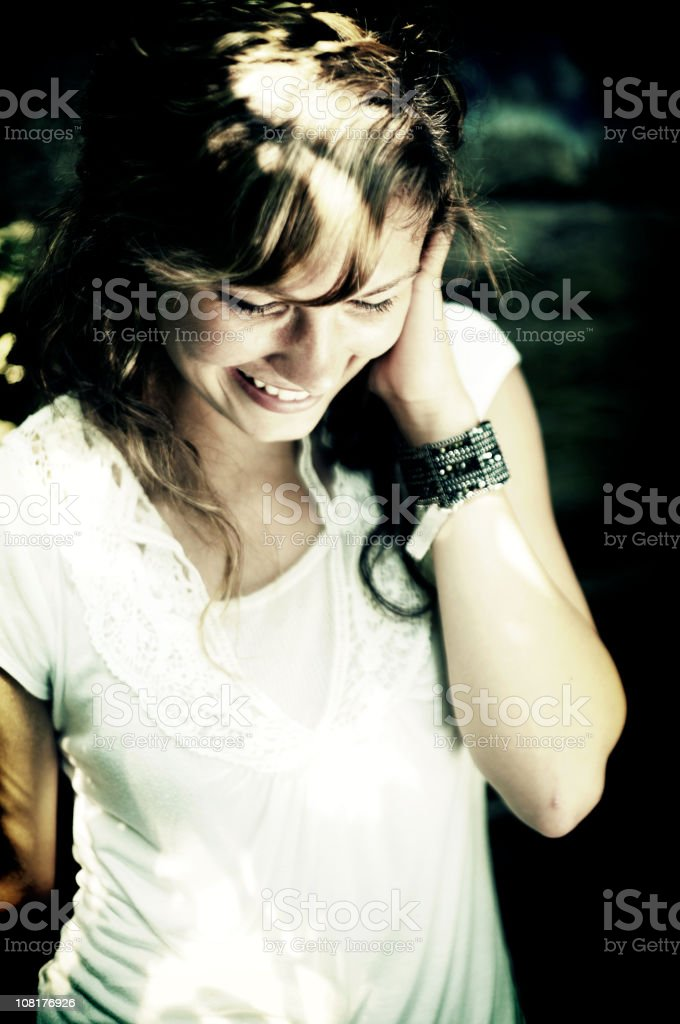 Portrait of Young Woman Smiling, Low Key royalty-free stock photo