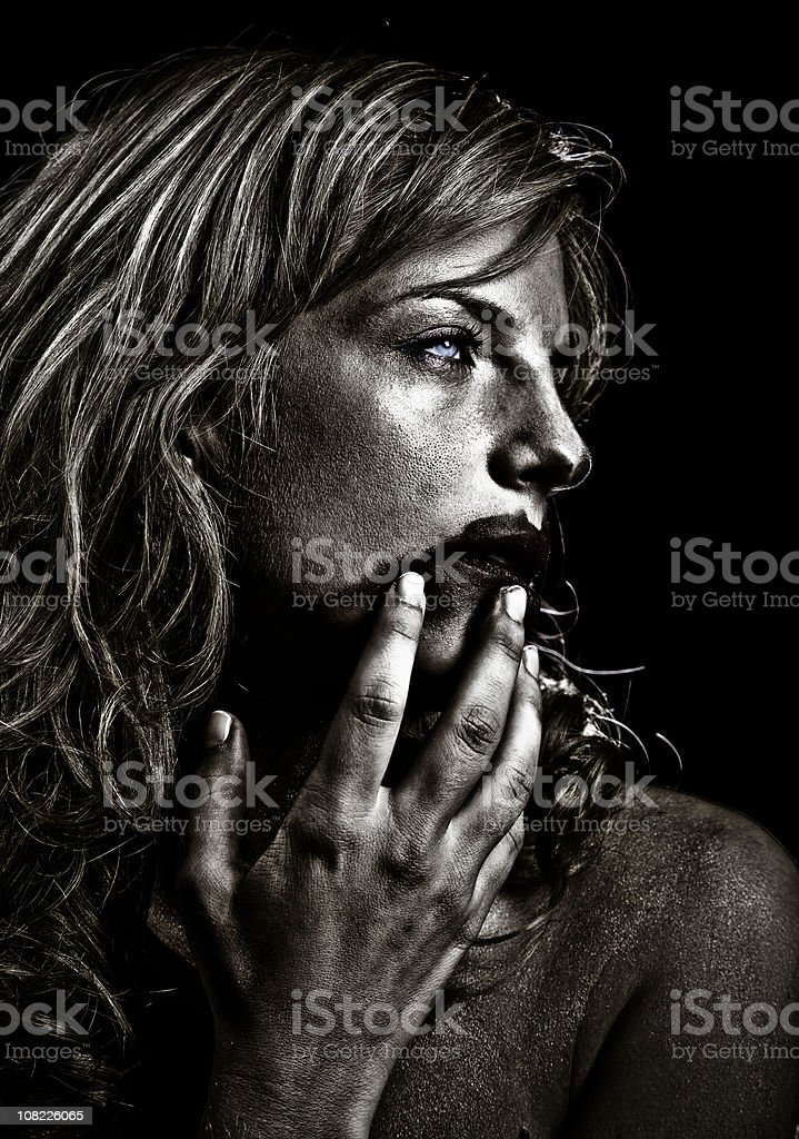 Portrait of Young Woman Smudging Lipstick on Face, Sepia Toned royalty-free stock photo