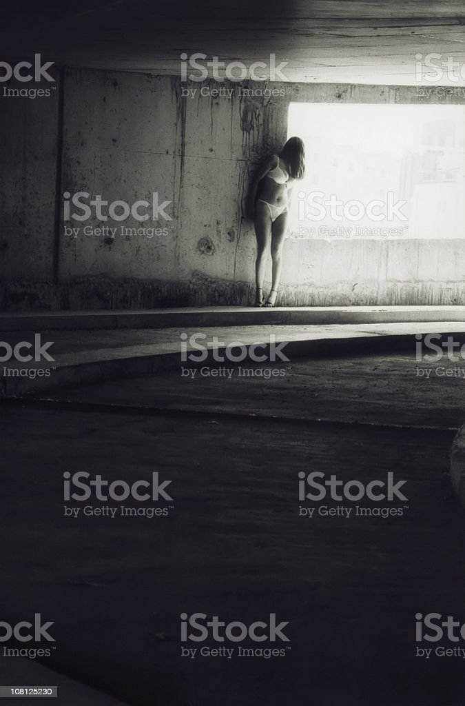 Portrait of Young Woman Standing in Parking Garage royalty-free stock photo