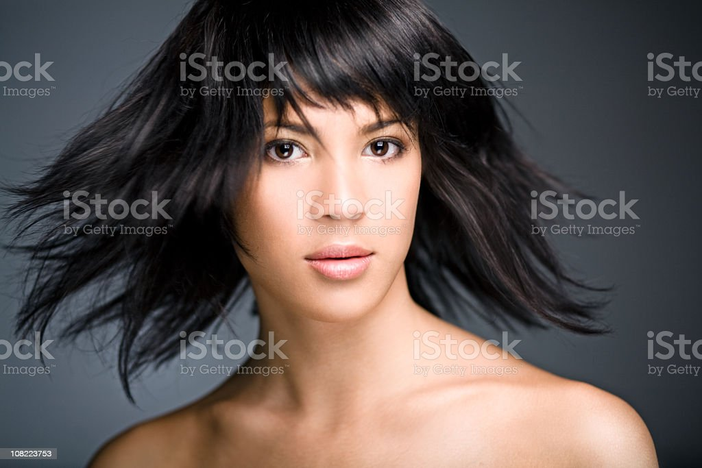 Portrait of Young Woman Swinging Hair royalty-free stock photo