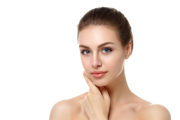Portrait of young woman touching her face stock photo