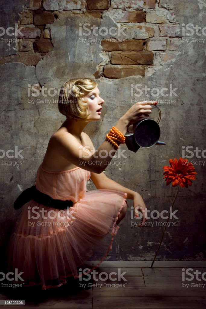 Portrait of Young Woman Water Flowering Indoors royalty-free stock photo