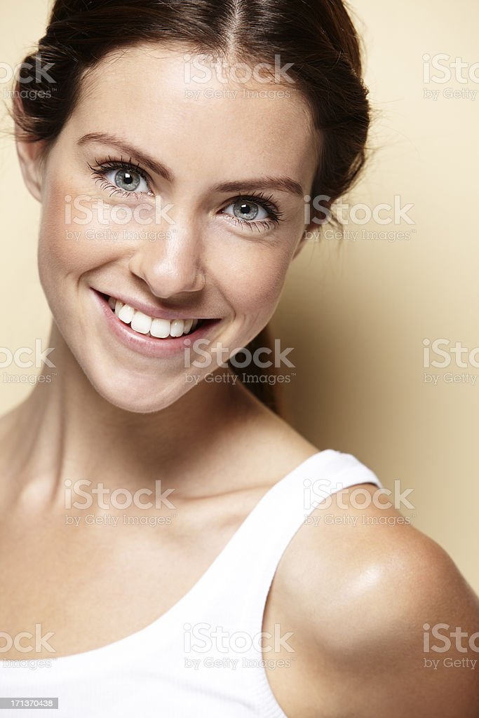 Portrait of young woman wearing a white top royalty-free stock photo