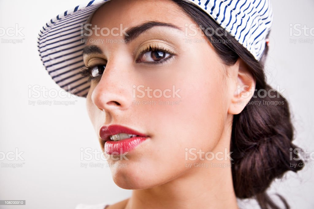 Portrait of Young Woman Wearing Blue Striped Hat royalty-free stock photo