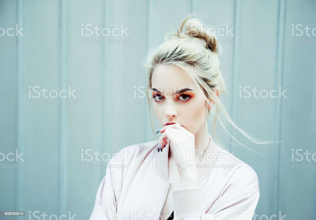 Portrait of young woman wearing bomber jacket stock photo