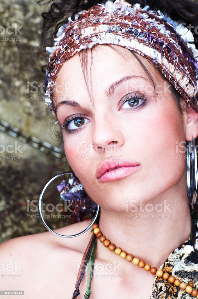 Portrait of Young Woman Wearing Earrings and Jewellery royalty-free stock photo
