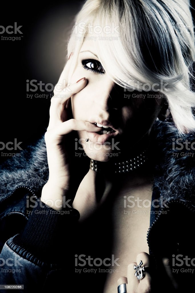 Portrait of Young Woman Wearing Fur Jacket, Low Key Toned royalty-free stock photo
