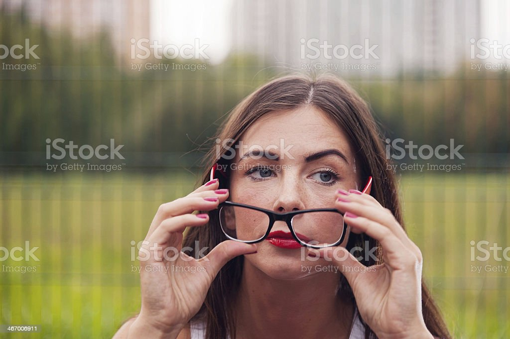 Portrait Of Young Woman Wearing Glasses On Playground stock photo