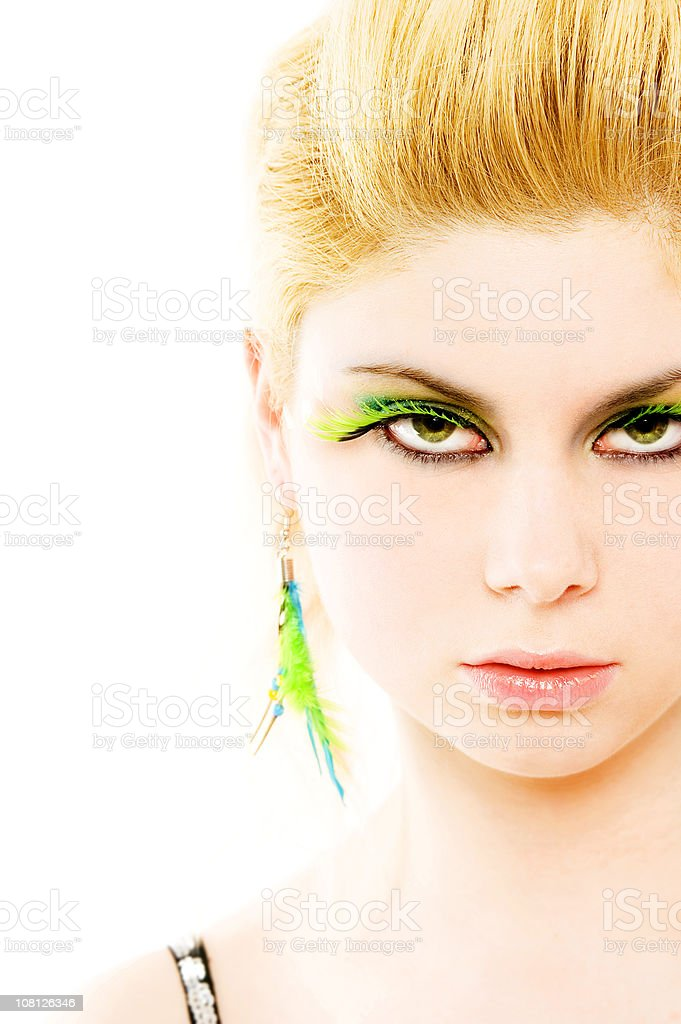 Portrait of Young Woman Wearing green false eyelashes royalty-free stock photo