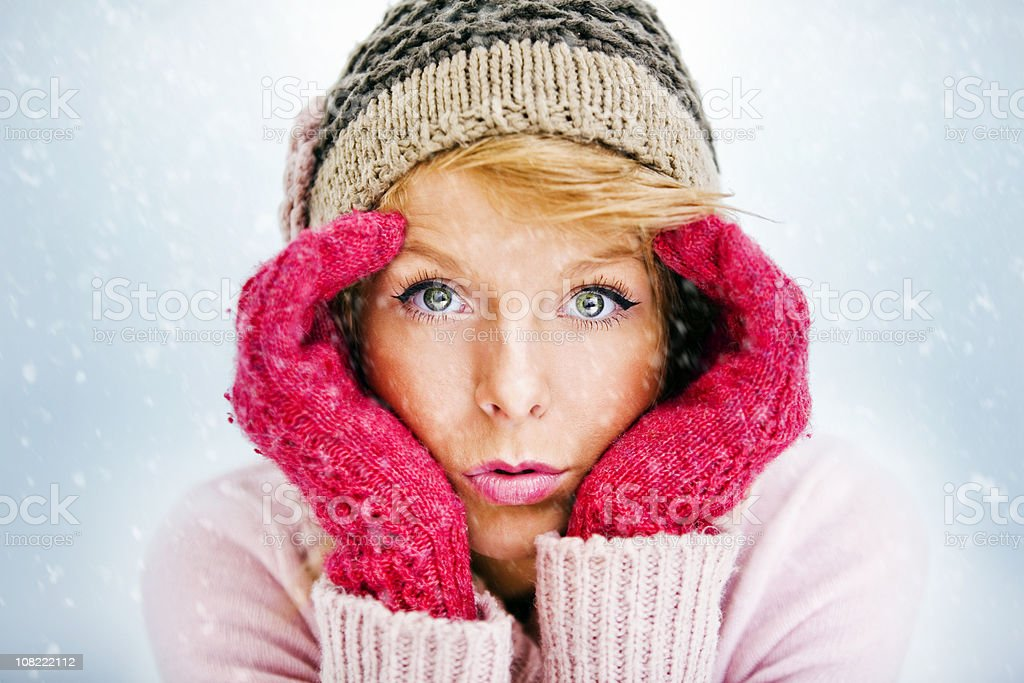 Portrait of Young Woman Wearing Hat and Gloves with Snow royalty-free stock photo