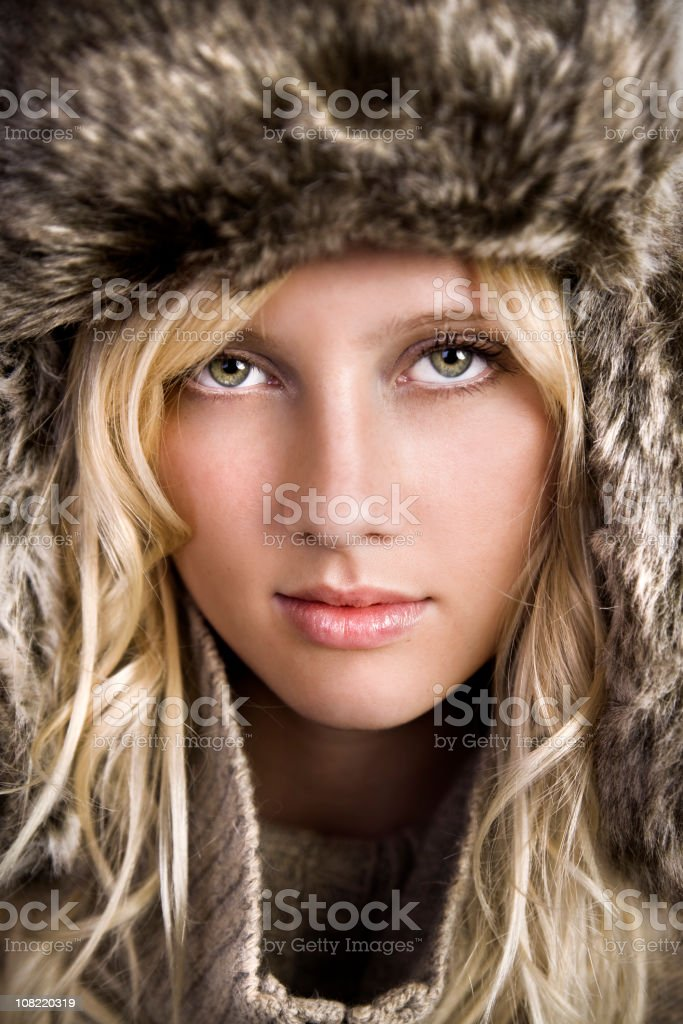 Portrait of Young Woman Wearing Winter Hat royalty-free stock photo