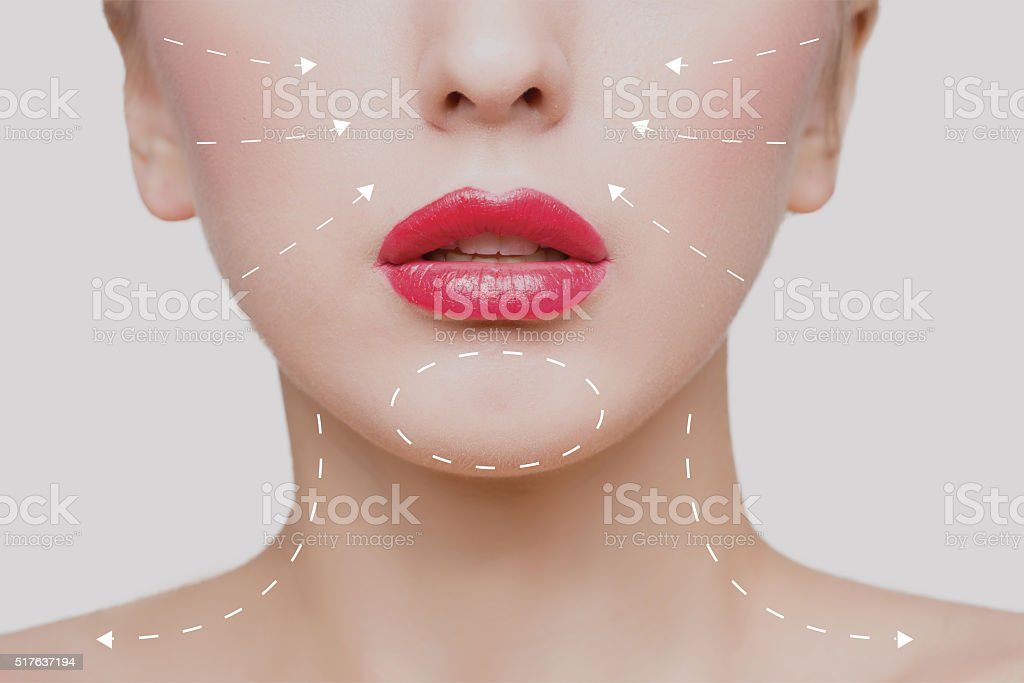 Portrait of young woman with arrows on her face stock photo