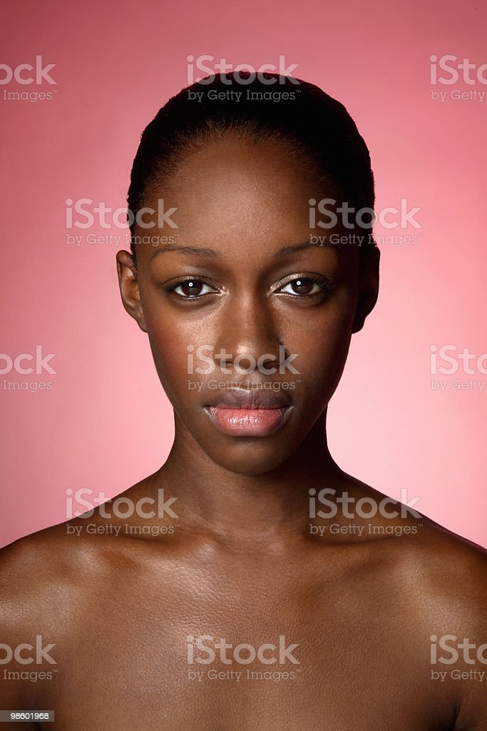 Portrait of young woman with bare shoulders royalty-free stock photo