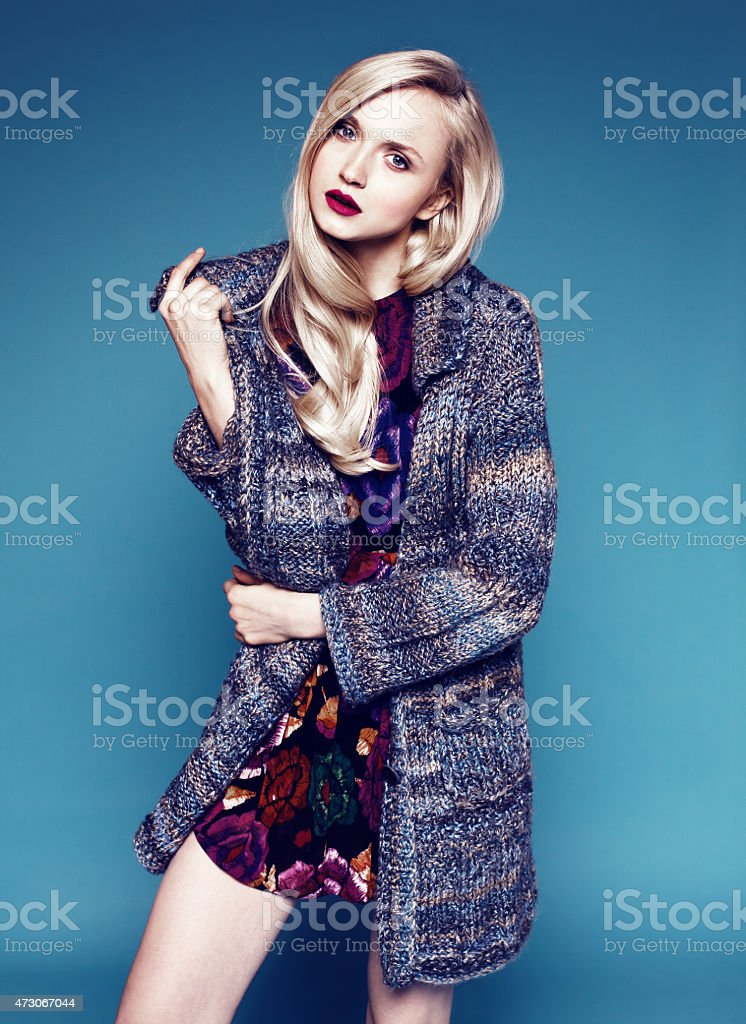 portrait of young woman with bright make-up and blond hair stock photo