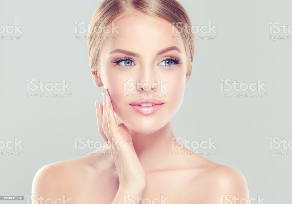Portrait of young woman with clean fresh skin and soft, delicate make up. - foto stock
