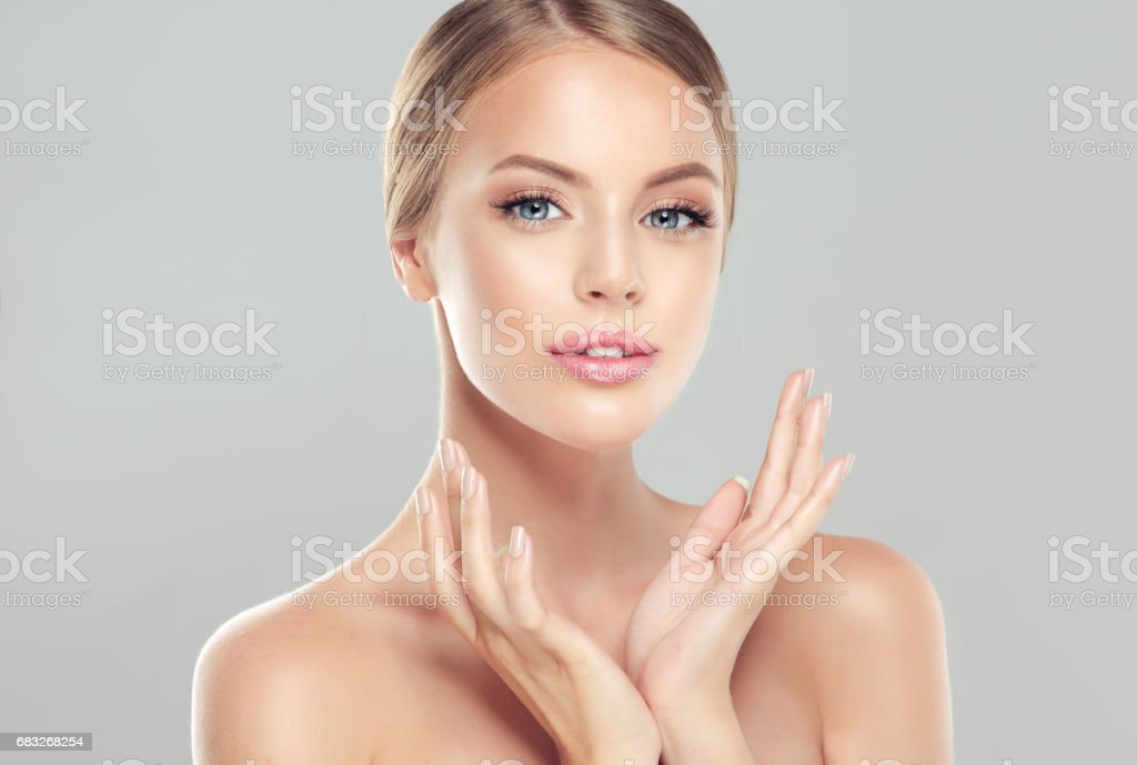 Portrait of young woman with clean fresh skin and soft, delicate make up. stock photo