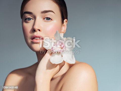 Portrait of young woman with clean skin and delicate make-up