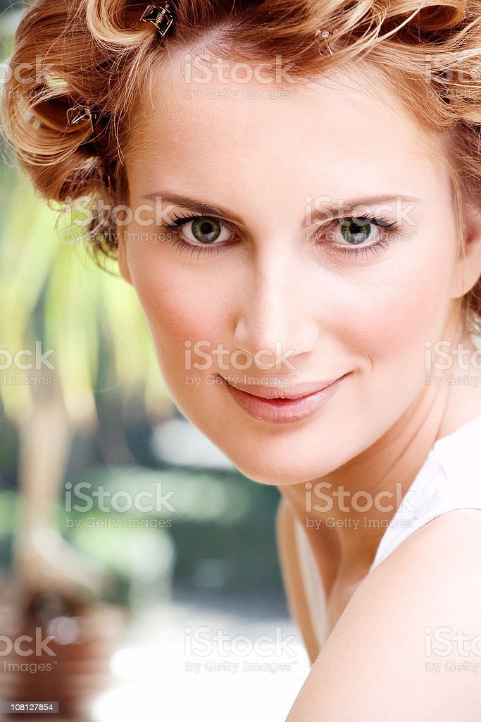 Portrait of Young Woman with Curlers in Hair stock photo