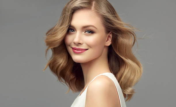 portrait of young woman with dark blonde hair. cosmetology, hairdressing and makeup. - beleza imagens e fotografias de stock