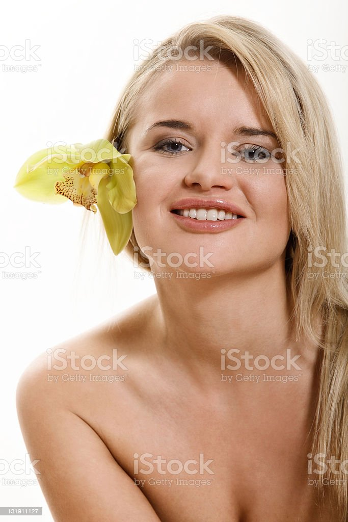 Portrait of young woman with flower stock photo