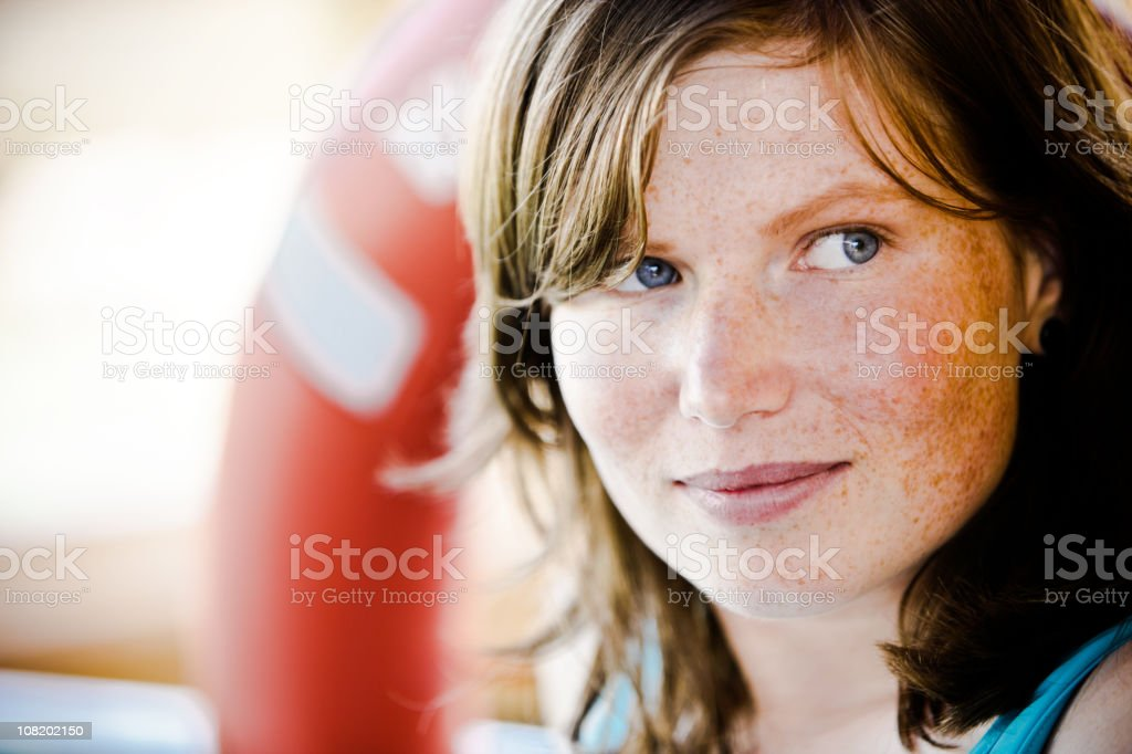 Portrait of Young Woman with Freckles Looking Away royalty-free stock photo