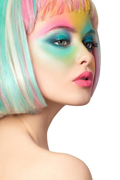 porträt der jungen frau mit lustigen make-up, isoliert auf weiss - regenbogen make up stock-fotos und bilder
