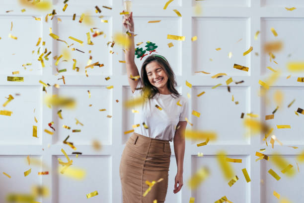 Portrait of young woman with glass celebrate Christmas or New Year stock photo