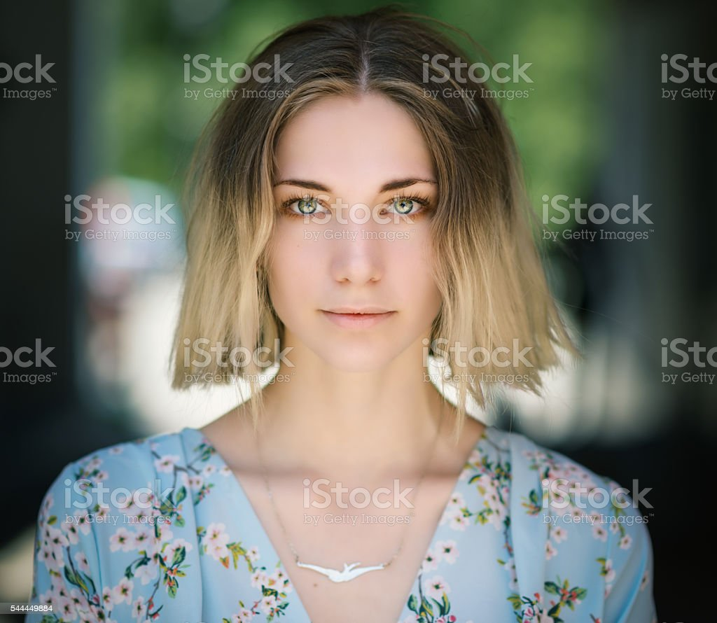 Portrait of young woman with green eyes. stock photo