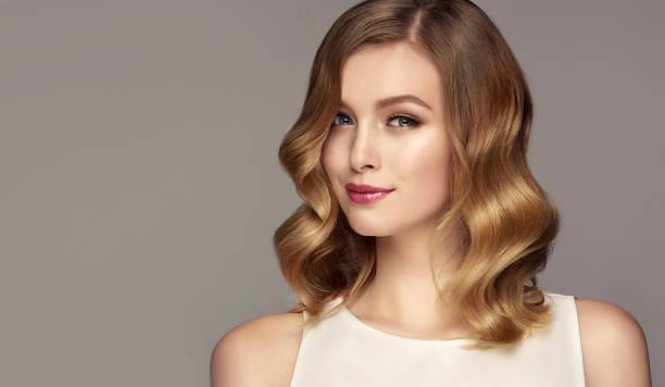 portrait of young woman with hair color of straw. cosmetology, hairdressing and makeup. - gładki zdjęcia i obrazy z banku zdjęć