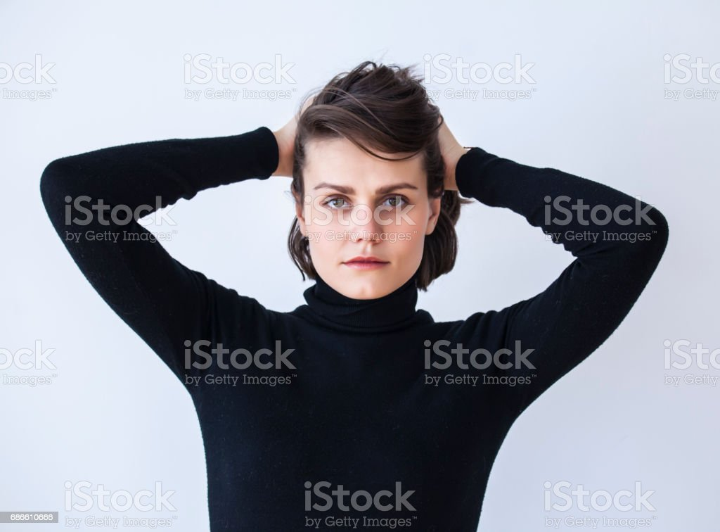 Portrait of young woman with hands in hair royalty-free stock photo