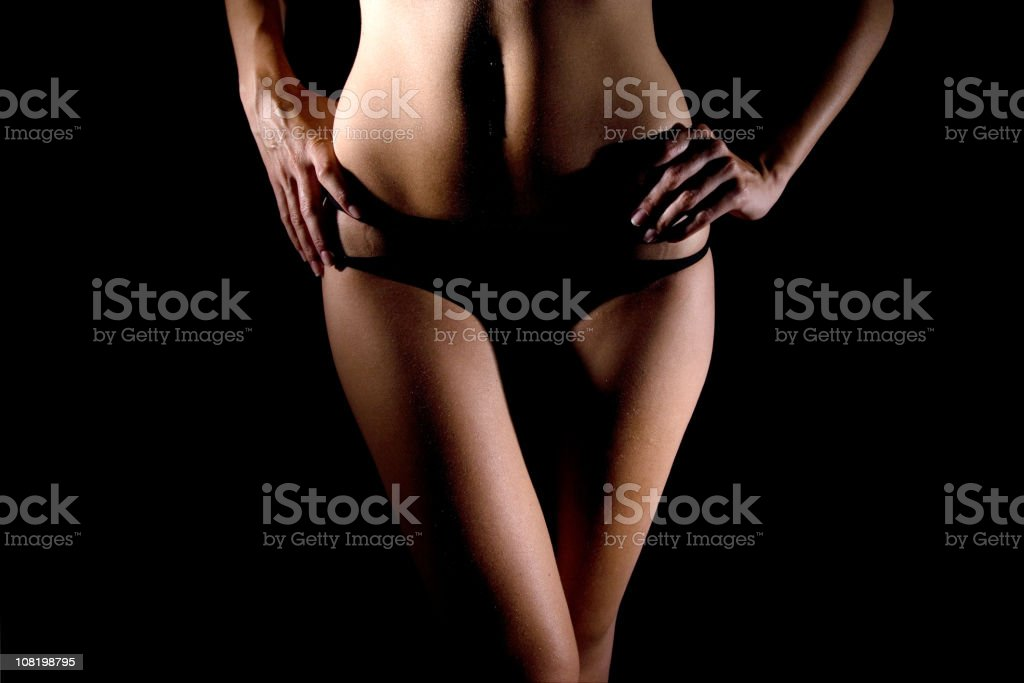 Portrait of Young Woman With Hands on Hips stock photo