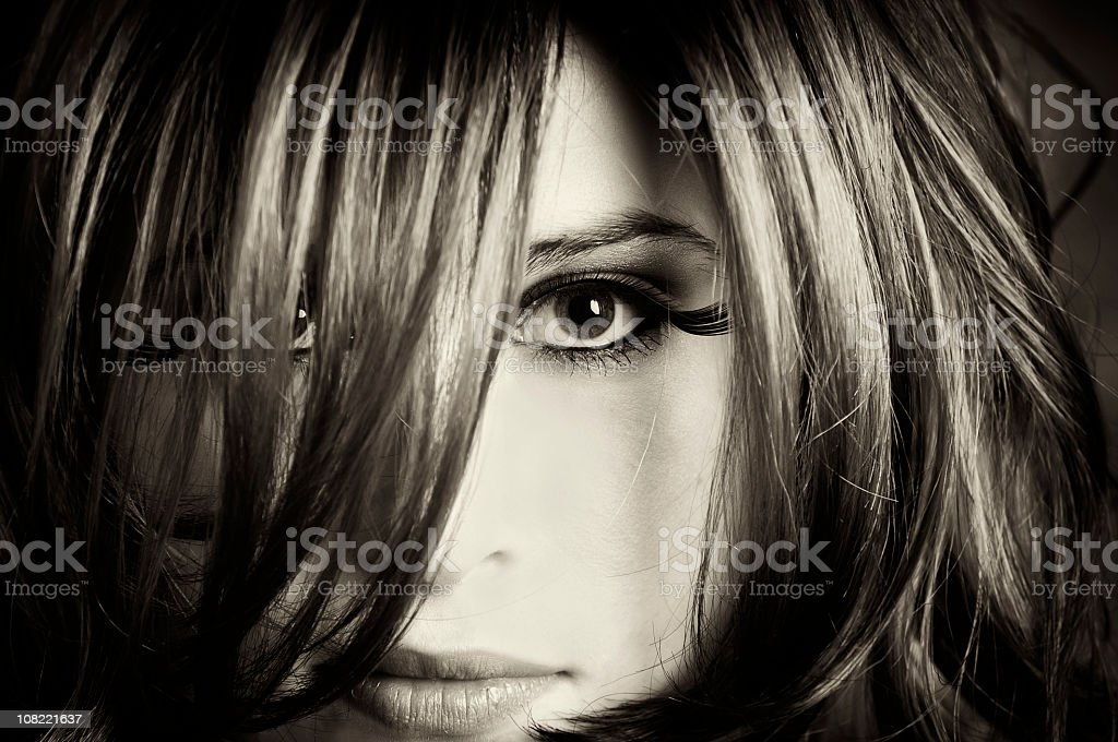 Portrait of Young Woman With Long Hair, Sepia Toned royalty-free stock photo