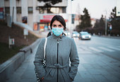 istock Portrait Of Young Woman With Mask On The Street. 1204066423
