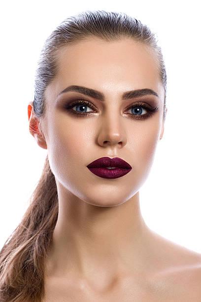 portrait of young woman with modern makeup - goldenes augen make up stock-fotos und bilder