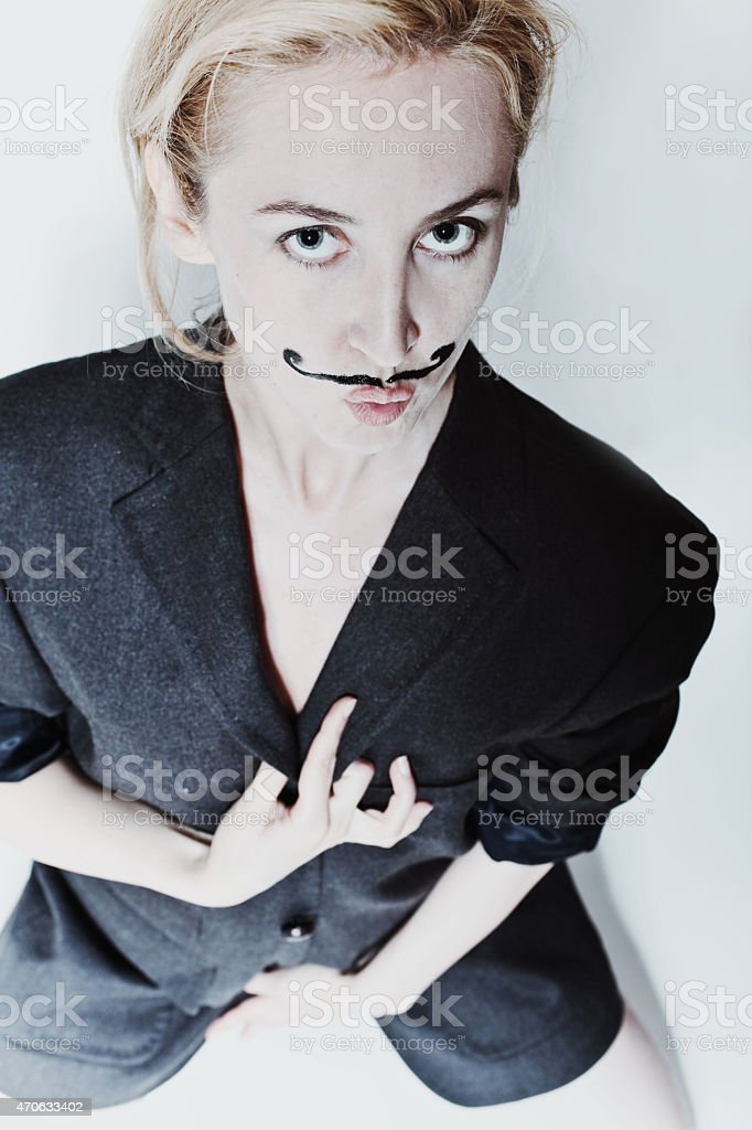 Portrait of young woman with painted mustache stock photo