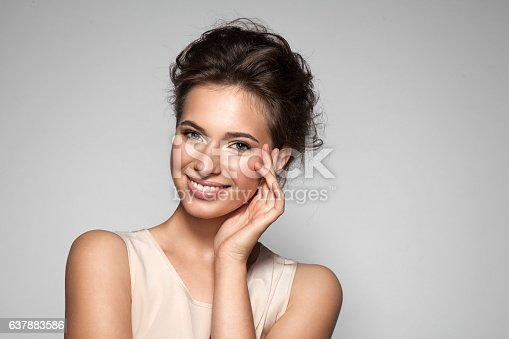 Portrait of young woman with perfect  clean skin with natural make-up