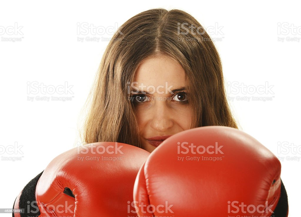 Portrait of young woman with red boxing gloves royalty-free stock photo