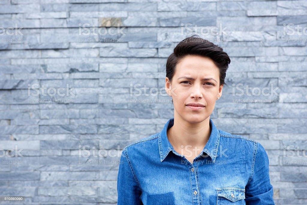 Portrait of young woman with short hair stock photo