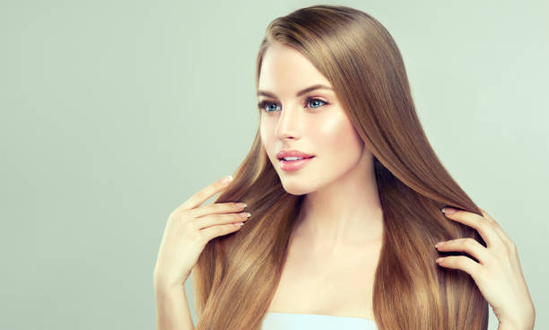 Portrait of young woman with straight, loose hairstyle on the head. Hairdressingand beauty technologies. stock photo