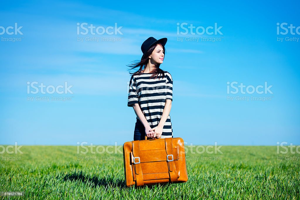 portrait of young woman with suitcase stock photo