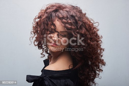 Portrait of young woman with trend curly hair, professional hair coloring