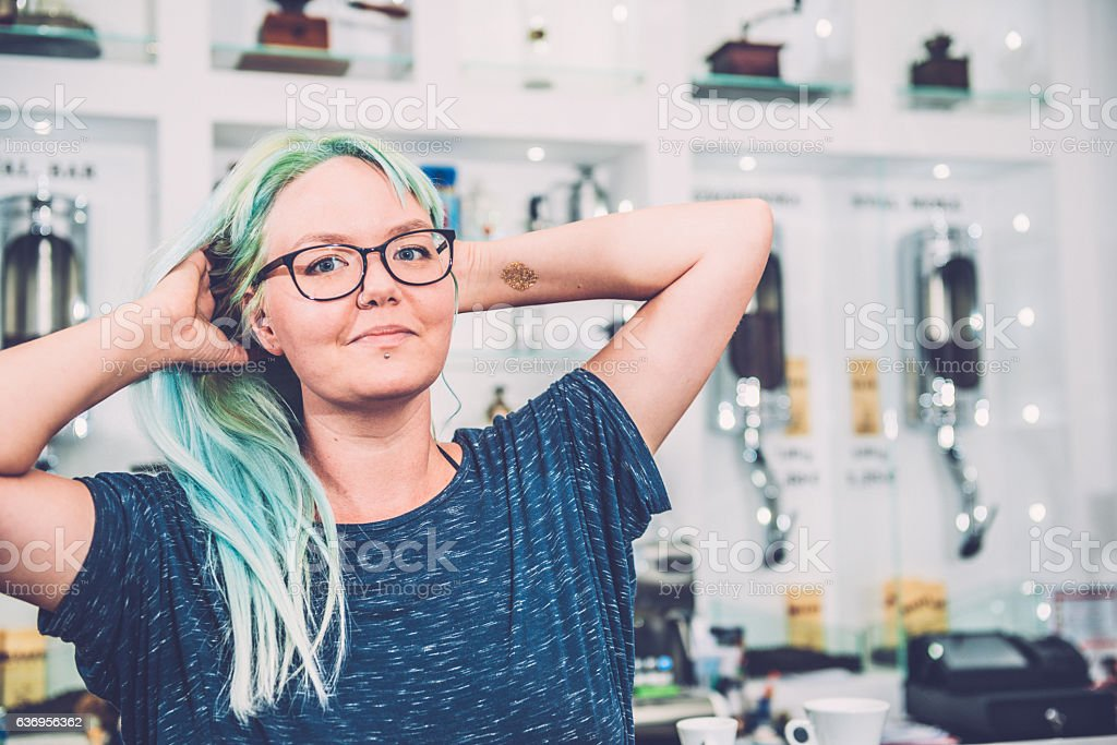 Portrait of Young Woman with Turquoise Dyed Hair, Cafe, Slovenia stock photo