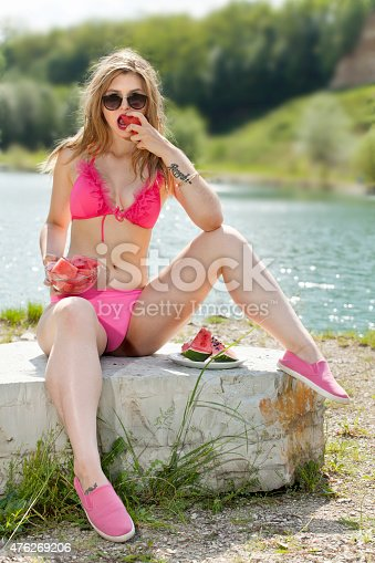 istock Portrait of young woman with watermelon refreshes. 476269206